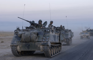 041001-F-2034C-017 U.S. Army armored vehicles leave Samarra after conducting an assault during Operation Baton Rouge in Samarra, Iraq, on Oct. 1, 2004.  Soldiers of the 1st Battalion, 4th Cavalry Regiment, 1st Infantry Division conducted the assault and then surrounded Samarra sealing it off to keep anti-coalition forces from entering or leaving the town.  DoD photo by Staff Sgt. Shane A. Cuomo, U.S. Air Force.  (Released)